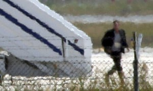 A man thought to be the hijacker leaves the hijacked Egyptair plane.