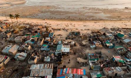 FILES-MOZAMBIQUE-CLIMATE-ENVIRONMENT-WEATHER-BEIRA-CYCLONE(FILES) In this file photo taken on April 01, 2019 debris and destroyed buildings which stood in the path of Cyclone Idai can be seen in this aerial photograph over the Praia Nova neighbourhood in Beira. - Daviz Simango, mayor of Beira on the Mozambican coast, had worked hard to shore up the city's climate defences, drawing on World Bank help to build deterrents against rising seas, flooding and storms. But in just a few hours last month, Cyclone Idai devastated the city of half-a-million people and wiped out his efforts. (Photo by Guillem Sartorio / AFP)GUILLEM SARTORIO/AFP/Getty Images