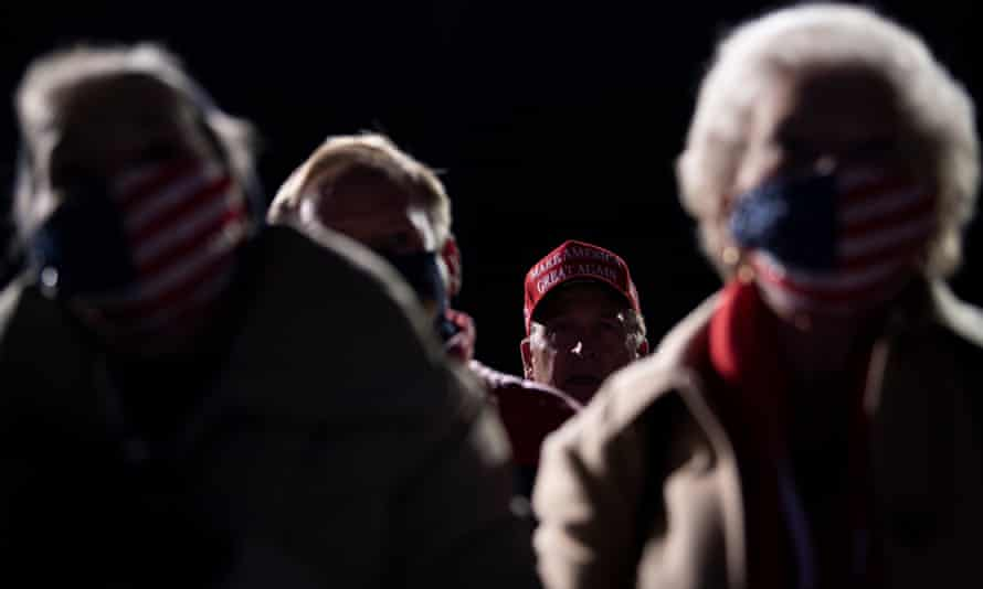 Supporters listen to US president Donald Trump speak at a Make America Great Again rally at Eppley Airfield in Omaha, Nebraska. Hundreds of people were stranded for hours in the freezing cold.