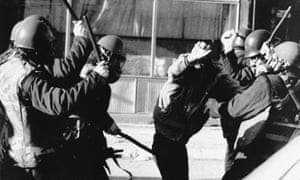 A young ethnic Albanian is clubbed by several riot policemen during clashes in the provincial capital of Kosovo 27 March 1989.