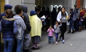 Hundreds of people overflow on to the sidewalk in a line snaking around the block outside a US. immigration office with numerous courtrooms in San Francisco last year.