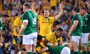 Tom Robertson of Australia celebrates after team-mate David Pocock scored a try.