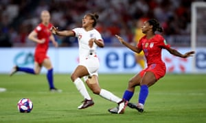 Nikita Parris of England is challenged by Crystal Dunn of the USA.
