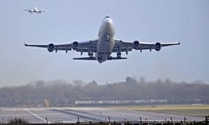 An airplane takes off at Gatwick Airport, after the airport reopened to flights following its forced closure because of drone activity