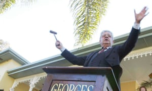 A real estate agent starts the bidding at an auction