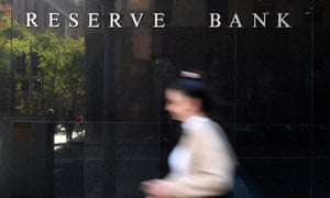 A person walks past the Reserve Bank of Australia building in Sydney