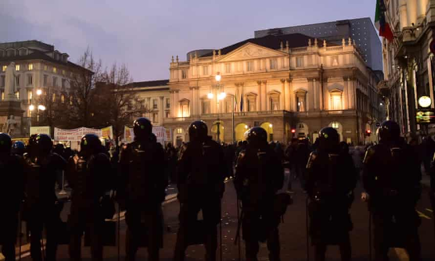 Police standing guard outside La Scala, Milan, 7 December 2015.