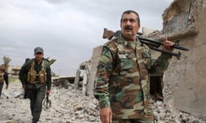 Kurdish Peshmerga fighters search for Isis militants in Tel Asqof, northern Iraq.