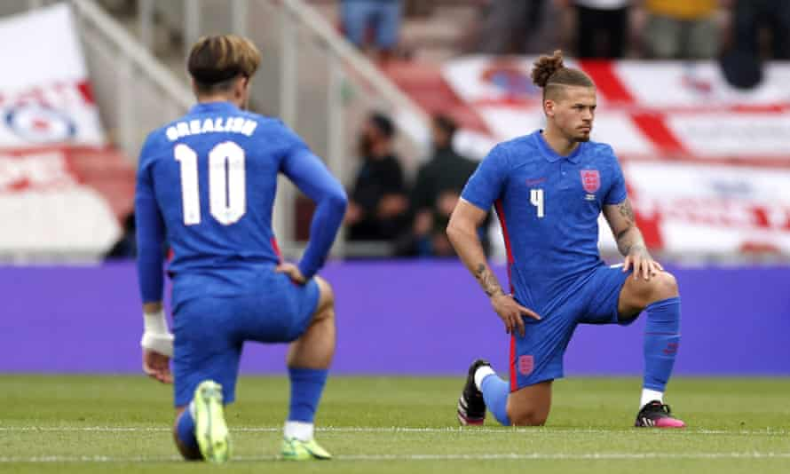 England's Jack Grealish (left) and Kalvin Phillips take a knee before England's friendly against Romania at the Riverside Stadium.