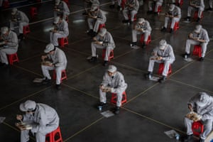 Wuhan China Workers have lunch while sitting 1.5 metres away from each other at Dongfeng Honda in Hubei province. The car manufacturer says 95% of its labour force has returned to their posts after the long Covid-19 break