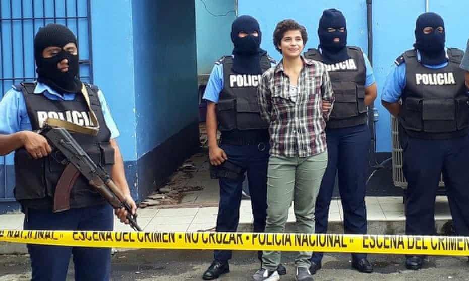 Amaya Eva Coppens  being held by police
