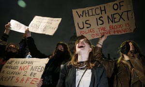 Protesters hold signs and shout during a protest criticising the actions of the police at last night's vigil on Parliament Square on March 14, 2021 in London, England.
