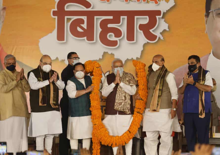 India's prime minister, Narendra Modi, being garlanded by BJP leaders.