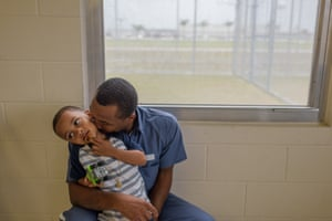 Arnaldo, 28, kisses his son Joseph, 4, during a visit at the Okeechobee correctional institution in Okeechobee, Florida