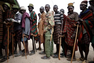 Turkana tribesmen wait to vote at a polling station in a village near Baragoi