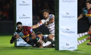 Harlequins' Fijian back-row forward Semi Kunatani bursts under the posts to score his side's second try.