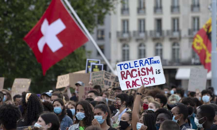 Protesters take part in a Black Lives Matter demonstration, in Geneva in July