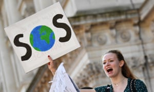 A climate protestor holds a sign during February's climate strike in London.