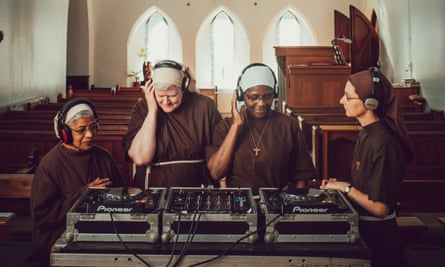 The sound of music: four of the Poor Clares of Arundel get to grips with the recording equipment.