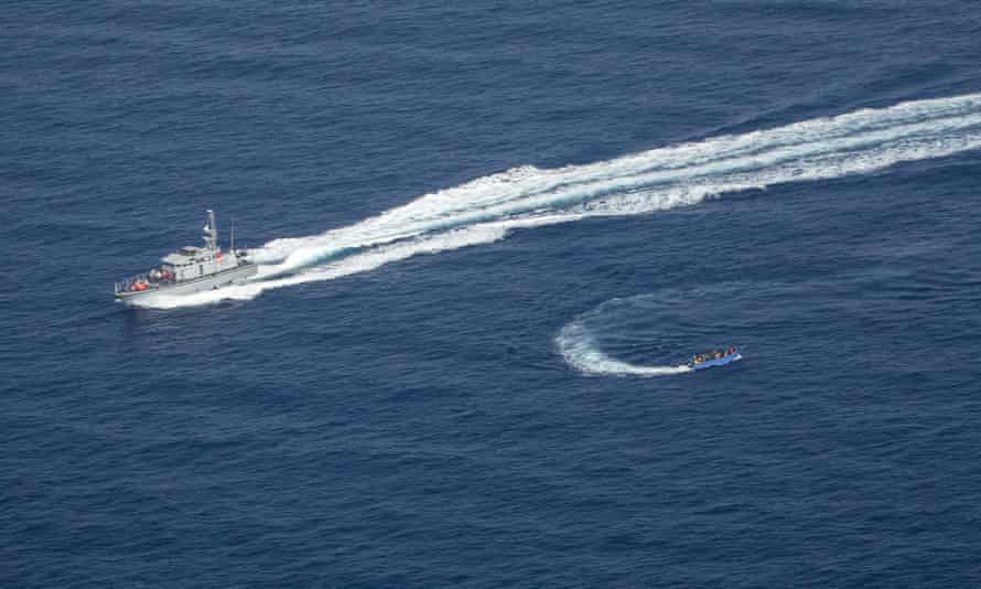 A picture taken on 30 June from the Sea-Watch plane. Libyan coastguards threw objects at the migrant boat and pulled a rope with a buoy behind it to 'catch' it as well as firing and trying to ram it, Sea-Watch said