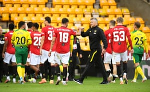 Manager Ole Gunnar Solskjaer celebrates with his players at full time.