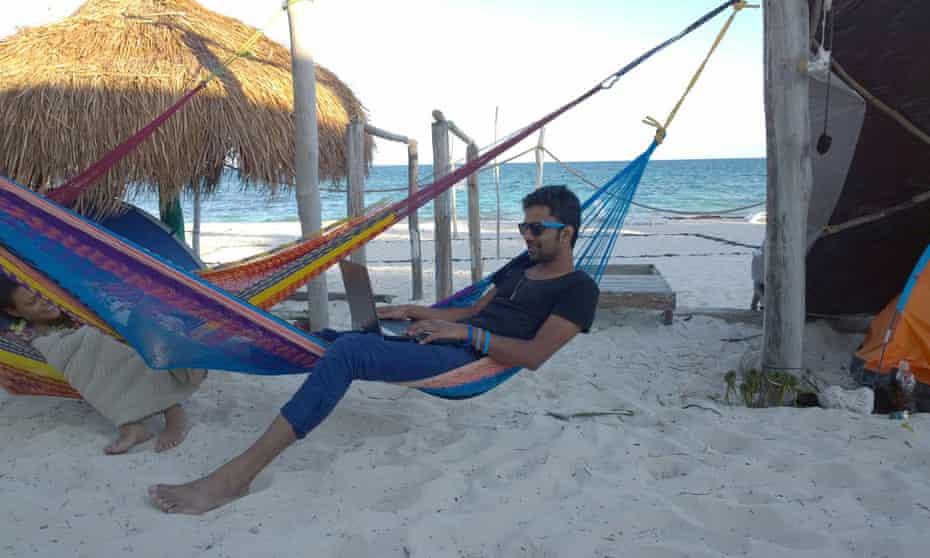 Danish Soomro in a hammock on the beach