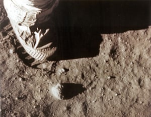 Neil Armstrong's right foot leaves a footprint in the lunar soil.