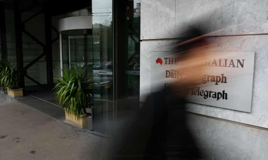 A pedestrian walks past the editorial headquarters of News Corp Australia