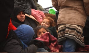 Women and children in the back of a truck near al-Ghazawiya, in Syria.