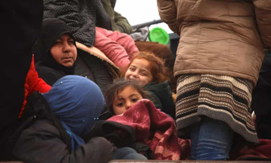 Women and children in the back of a truck near al-Ghazawiya, in Syria.