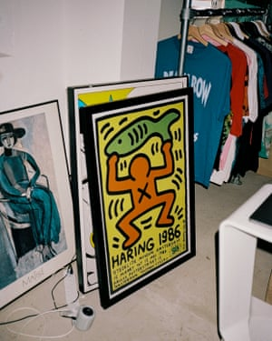 Colourful framed posters leaning against a wall
