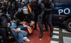 Clashes outside the Escola Ramon Llull polling station in Barcelona.
