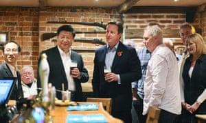 David Cameron and Xi Jinping drinking a pint of Greene King IPA.