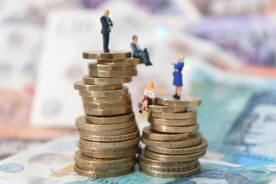 Photo-illustration of women and women figurines sitting on a stack of money