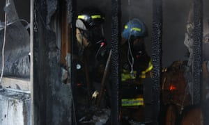 Firefighter at the scene of a fire at a hospital in Miryang, South Korea.