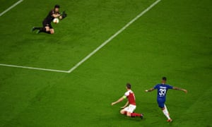 Arsenal keeper Petr Cech saves from Emerson of Chelsea.