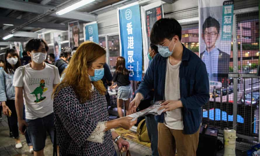 Pro-democracy campaigners distribute flyers protesting against China's controversial national security law for Hong Kong