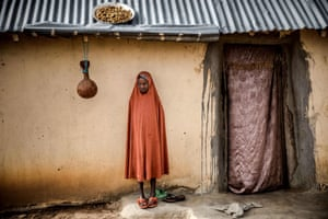 A Fulani girl waits outside her house at Kachia grazing reserve, Kaduna state