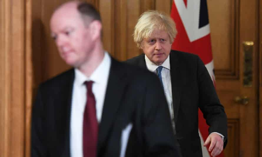 Boris Johnson (right) and Chris Whitty arrive for a Covid-19 media briefing at Downing Street in February.