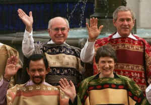 <strong>Chile 2004:</strong> On the back row are John Howard and George W Bush wearing the traditional chamanto.