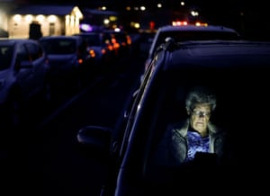 Woman reads in her car in the dark