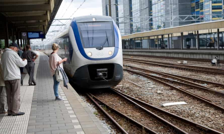 Intercity train arriving at Leiden Central railway station, Netherlands.