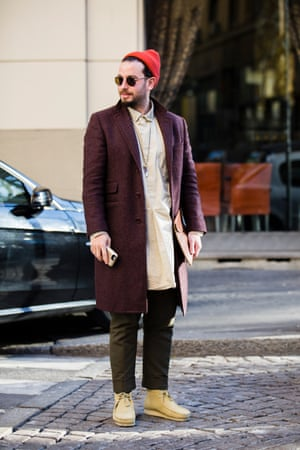 A real street-style star during Milan men's fashion week, clutch in hand.