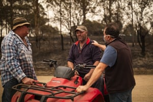 Steve Shipton (centre) is consoled by fellow farmers Bernie Smith (left) and Peter Mercieca in Coolagolite, NSW, January 1, 2020.