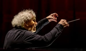 Sir Simon Rattle conducts earlier this year