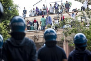 Squatters and riot police confront each other during an eviction in Rome, Italy