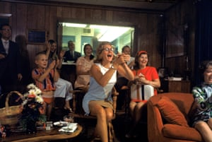 Joan Aldrin applauding her husband as she watches TV coverage of splashdown at end of mission.
