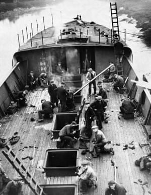 Workers caulk the deck of the trawler Larwood in December 1935, one of a fleet of Grimsby trawlers named after famous cricketers.