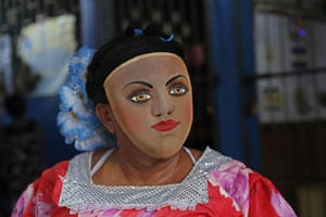 A man in costume dances during the start of festivities to honour Saint Dominic in Managua, Nicaragua