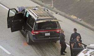Los Angeles police officers are seen after a pursuit of a stolen hearse on Interstate 110 in South Los Angeles on Thursday.